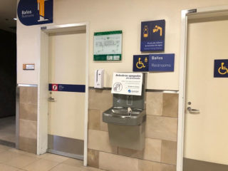 Bathrooms Quito Airport Signage
